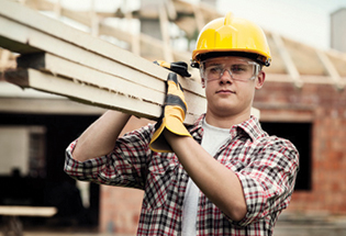construction worker carrying wood